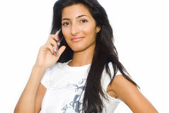 Girl and phone on white background stock photography
