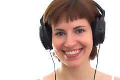 Girl with phones. Young girl with black ear flaps on white Stock Photo