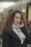 Girl phoning in train station. Beautiful girl phoning in train station Royalty Free Stock Image