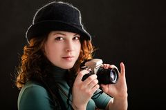 Girl with a photo Royalty Free Stock Image