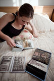 Girl with photo-album Stock Images