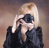Girl with photo camera Royalty Free Stock Photos