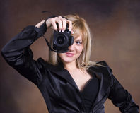 Girl with photo camera Stock Photo