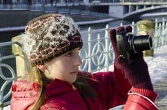 Girl and photo camera Royalty Free Stock Photos