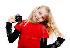 Girl with photo camera. Royalty Free Stock Image