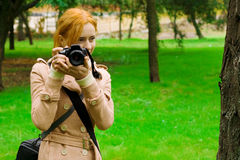 Girl with a photo camera Royalty Free Stock Images