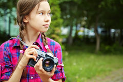 Girl with photo camera Stock Photos