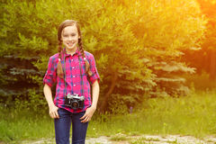 Girl with photo camera Royalty Free Stock Photography
