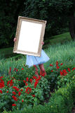 Girl with a photo frame Royalty Free Stock Photo