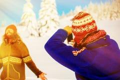 Girl photo of a man in a beautiful mountain snowy landscape. Sun effect. stock photos