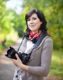 Girl with photocamera Stock Photos