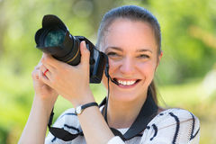 Girl with photocamera at park Royalty Free Stock Images