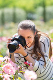 Girl with photocamera at park Stock Photography