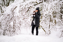 Girl photographed in snowy forest Stock Photography