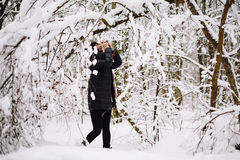 Girl photographed in snowy forest Stock Photos