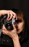 The girl the photographer. The girl photographs on the old film camera stock photos