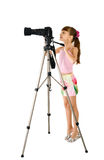 The girl - photographer. Is photographed on the white background Stock Photography