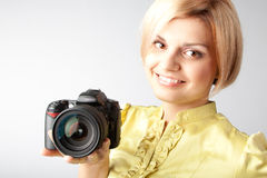 Girl-photographer. Young and beautiful girl with a professional camera in hand Stock Photos