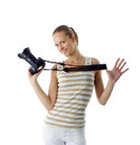 Girl photographer. Young and beautiful fashion model posing with professional photo camera. Isolated over white background stock images