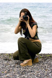 The girl the photographer. On a sea beach Royalty Free Stock Images
