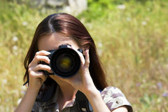 The girl the photographer. Photographing Royalty Free Stock Image