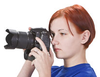 Girl photographer. Portrait of a redheaded girl photographer isolated against a white background Royalty Free Stock Photos
