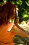 Girl photographer is back Royalty Free Stock Photography