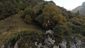 Girl photographer blonde in a hat walks with a camera in the mountains. Chegem gorge North Caucasus stock video