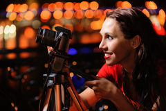 Girl-photographer with camera Royalty Free Stock Photos