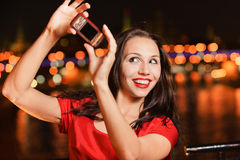 Girl-photographer with camera Royalty Free Stock Images
