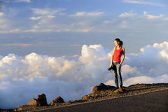 The girl - photographer in clouds. Royalty Free Stock Photography