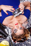 Girl photographer with creative makeup holding camera. Royalty Free Stock Photography