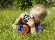 Girl photographer. Little Girl photographer taking pictures Stock Image