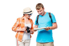 Girl photographer and male tourists looking at the map Royalty Free Stock Photo