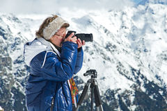 Girl photographer mountains Royalty Free Stock Photos