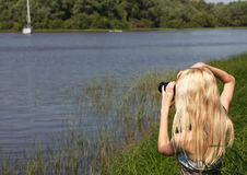 Girl photographer on the nature. Stock Images
