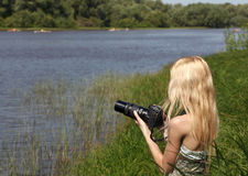 Girl photographer on the nature. Royalty Free Stock Images