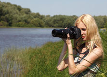 Girl photographer on the nature. Stock Photos