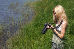 Girl photographer on the nature. Royalty Free Stock Photo