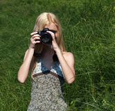 Girl photographer on the nature. Stock Image