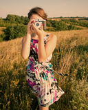 Girl photographer. Photographing landscape at sunset Royalty Free Stock Photo