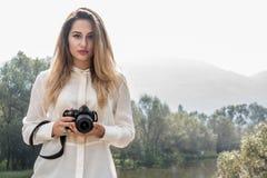 Girl photographer Stock Photography