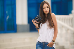 Girl photographer with professional SLR camera Royalty Free Stock Image