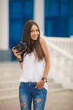Girl photographer with professional SLR camera Royalty Free Stock Images