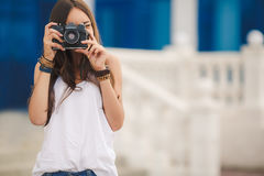 Girl photographer with professional SLR camera Stock Photography