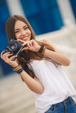 Girl photographer with professional SLR camera Royalty Free Stock Photos