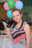 The girl the photographer at restaurant. Stock Images
