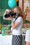 The girl the photographer at restaurant. Royalty Free Stock Photography