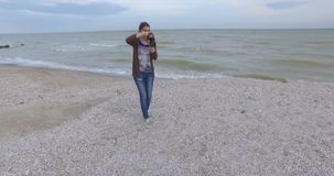 The girl photographer shoot on the beach. stock video footage