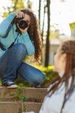 Girl photographer shoot model Royalty Free Stock Image